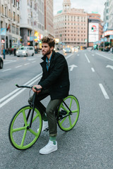 Young Man Riding a Custom Fixie on a Crowded Street