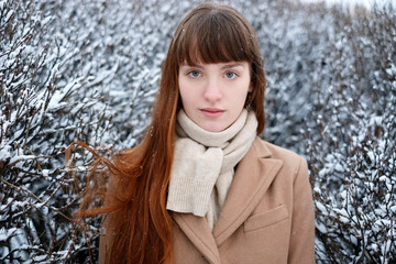 Portrait of young woman looking at camera in winter