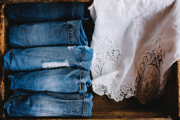 Selection of denim jeans with a white lace shirt