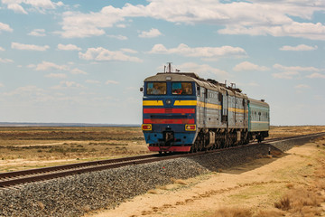 Locomotive train is passing through Kazakhstan desert