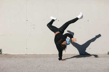 Young african american woman performing street dance in the city.