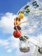 Colourful cabins on a ferris wheel on an amusement park.