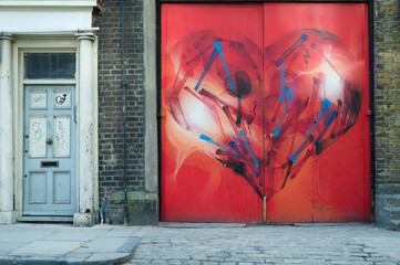 Colourful red heart graffiti  in London