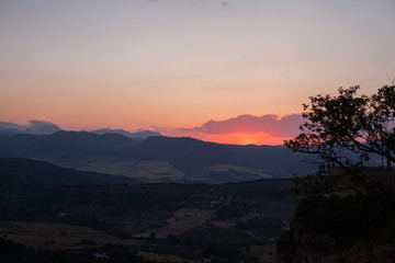 Orange sunset over a valley in Spain