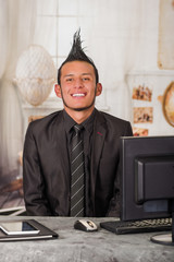 Close up of office punk worker wearing a suit with a crest in a blurred background