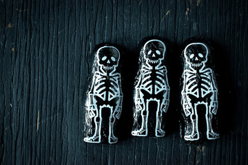 Halloween skeleton chocolate candy on dark wood setting