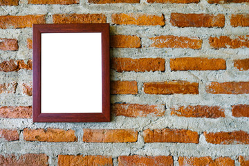 Blank picture frame on brick wall background.