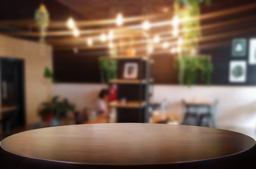Selected focus empty brown wooden table and Coffee shop or restaurant blur background with bokeh image. for your photomontage or product display.