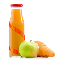 Glass bottle of fresh healthy juice with carrot and apple isolated on white