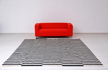 Black and white striped carpet on floor in living room