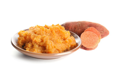 Plate with mashed sweet potato on white background