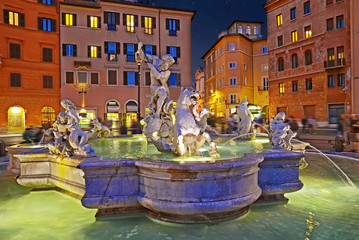 Amazing panoramic view   of the Fountain of Neptune in Piazza Navona at night. Rome, Italy