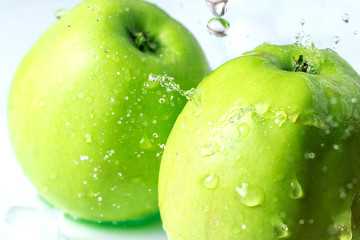 Apple with ice and water splash