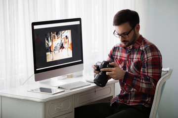 Portrait of young attractive man doing design work