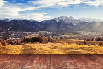 Fotoväggar - Table on autumn mountains background