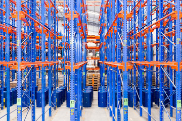 logistic, storage, shipment, industry and manufacturing concept - storing at warehouse shelves