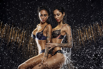 Sexy twins in water splash
