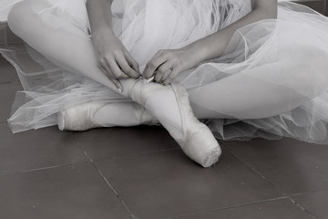Ballet dancer's legs with pointe shoes