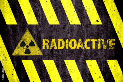 Radioactive Ionizing Radiation Danger Symbol And Word With Yellow