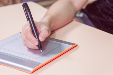 Stylus pen on hand working  tablet retoucher with designer and photographer with computer and graphic