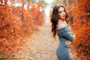 Young sexy woman in the autumn forest