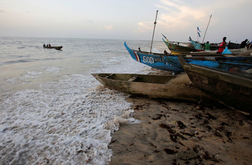 Boats are seen at the beach, in the township of West Point, in Monrovia, Liberia,