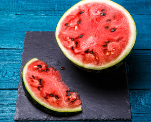 Image of cut watermelon in blue table