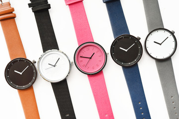 Set of multicolored wristwatches isolated on white background