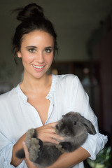 Smiling woman with cute hare
