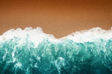 Wave Of Teal Ocean On Sandy Beach