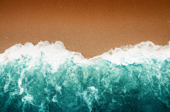 Wave Of Teal Ocean On Sandy Beach