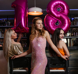 Female 18 birthday party in night club. Young women company in bar, stylish friends. Beautiful models, celebration together, beauty concept