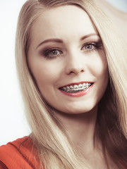 Elegant woman showing her teeth with braces
