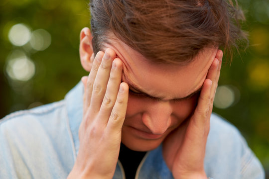 Man with headache, migraine or stress. Help, troubles in communication, overworking concept