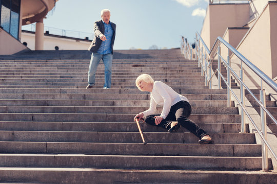 Senior woman falling down the stairs