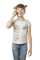 A young girl with blond hair is talking on the phone. A happy face. White isolated background