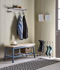 Interior of bright hallway home. Hanging clothes on door