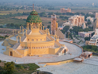 Garden Poster Temple Jain temple at the foot of Shatrunjaya Hill at Palitana, India. The buildings' steps indicate that making an ascent to a holy place is central to Jainism