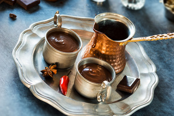 Spicy Spanish Hot Chocolate in Small Metal Cups with Pitcher on Tray