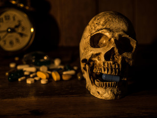 The skull is placed on a wooden table, The back of skull is drug and clock. With candles light from the sides and a wooden background.