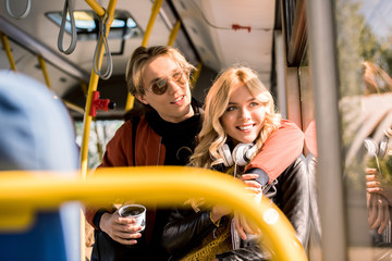 happy young couple in bus