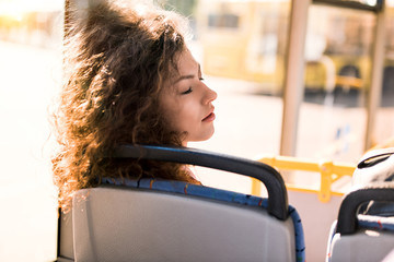 girl sleeping in bus