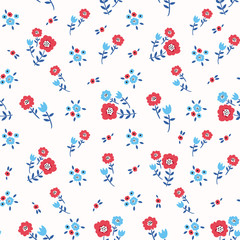 Floral seamless colorful pattern with blue and red flowers on white background. Ditsy floral background. Elegant and tender vector illustration for print, scrapbooking etc