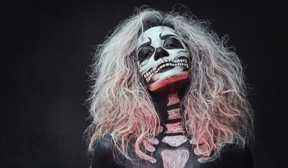 Halloween female skull makeup.