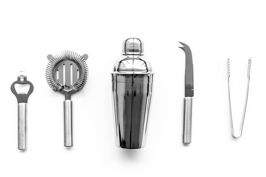 Barman equipment. Shaker, strainer on white background top view