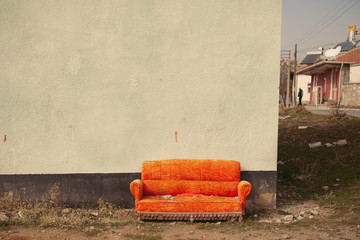 The Empty Orange Couch