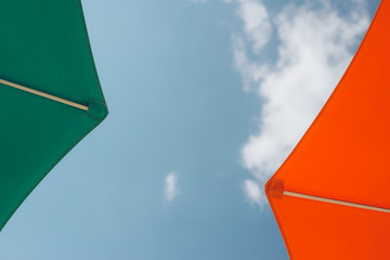 Two Colourful Sunshade Umbrellas