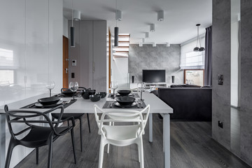 White table with black tableware