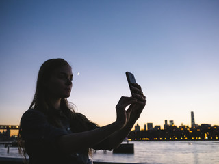 Young woman taking a selfie at sunset