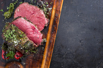 Barbecue wagyu chateaubriand with paprika as close-up on a cutting board